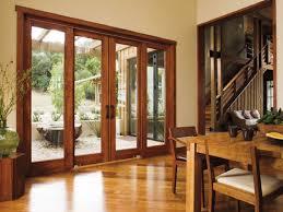sliding glass doors with blinds between craft room exterior