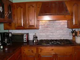 rustic white color faux stone backsplash mixed with glossed wood