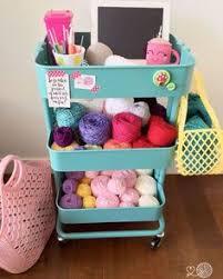 an ikea raskog cart full of colourful yarn and crochet supplies 10