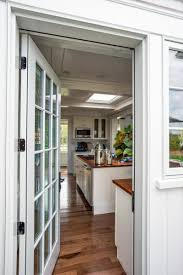 floor to ceiling windows and glass doors offer plenty of natural