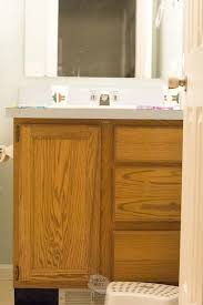 cost to paint kitchen and bathroom cabinets how to paint bathroom vanity cabinets that will last the