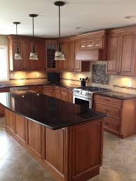 Kitchen Island Granite Countertop Black Granite Countertops In A Classic Wooden Kitchen With Kitchen