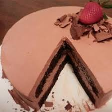 a classic chocolate sponge cake is the base of this greek tourta