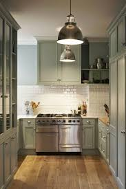 light moss green paint i like the simple white backsplash and mint color cabinets