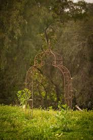 althea metal arch at found vintage rentals scrolling metal arch