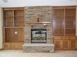 simple open wooden built in cabinet between stacked stones