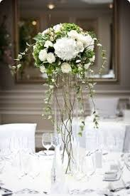 white and green tall wedding centerpiece designs by helen