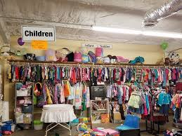 used clothing stores book dept is organized and includes a welcoming children s reading