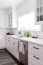 white shaker kitchen cabinets with white subway tile backsplash shaker kitchen cabinets with simple herringbone subway tile
