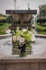 pretty white and green wedding bouquet hacienda sarria water