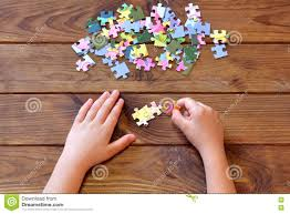 Jigsaw Puzzles Tables Child Holding Puzzles In Hands A Set Of Jigsaw Puzzles On Wooden