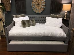 this upholstered twin daybed features nailhead trim and a