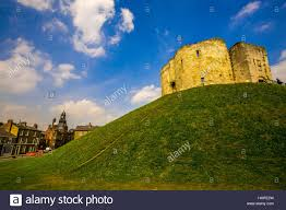 old english castle on a grassy hill stock photo royalty free