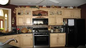 contemporary off white kitchen black appliances cabinets with