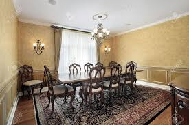 elegant dining room with large table in luxury home stock photo
