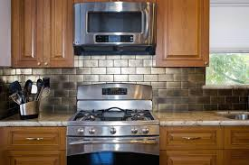 over the range microwave cabinet ideas awesome pachena place mediterranean kitchen vancouver by the sky in