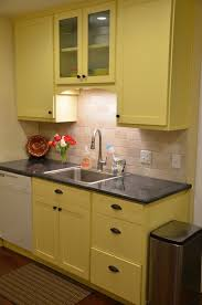white kitchen with backsplash granite countertop white kitchen cabinet styles how to cut