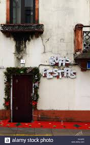 boas festas greeting and christmas decorations outside house vila