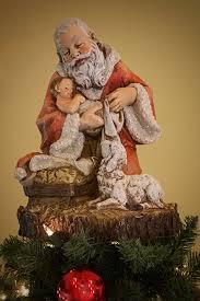 santa and baby jesus summit arbor kneeling santa with baby jesus christmas