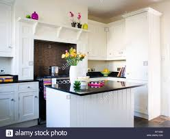 Traditional White Kitchen Images - island unit with black granite worktop in traditional white