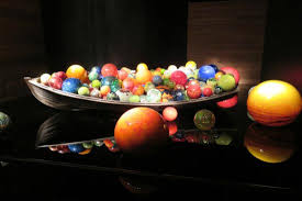 this is a size row boat with large glass balls inside picture
