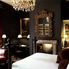 elegant bedroom with black walls and ornate wall mirror over the elegant bedroom with black walls and ornate wall mirror over the fireplace using bedroom mirrors