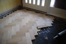 laying wooden floor parquet installation of parkay wooden flooring