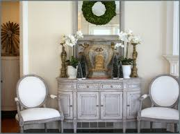holiday decor with grey and white swede in this view you can see at the left the swedish antique column cabinet in the hallway with gold sunburst decor on top which is from wisteria catalog