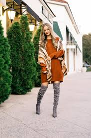 a casual thanksgiving day knee boot plaid and scarves