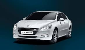 peugeot luxury car peugeot 508 hybrid4 diesel electric large sedan launched photos