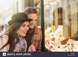 trendy couple is looking at engagement rings a grey hair man with