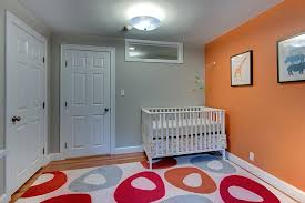 Modern Nursery Decor Orange Accent Wall For The Modern Nursery Room Decorating Ideas