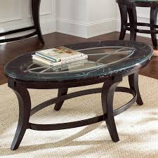 oval grey stone top coffee table and curved dark brown wooden base