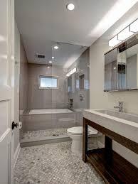 photos hgtv modern gray bathroom with glass enclosed shower and photos hgtv modern gray bathroom with glass enclosed shower and tub