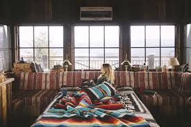 colorful interiors women blonde cabin snow blankets interiors window colorful