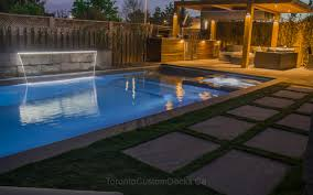 landscaping project with pools outdoor kitchen and firepit