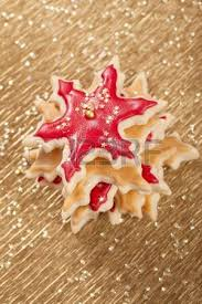 christmas cookies and biscuits stars golden and red stock photo
