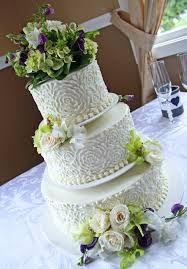 two tier purple and green wedding cakes wedding cake ideas