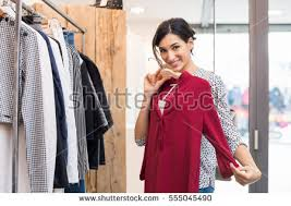 for clothes woman boutique selecting new clothes stock photo 551795569