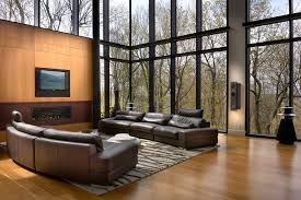 2 story living room two story window living room modern with tv above fireplace wooden