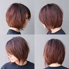 shorter hairstyles with side bangs and an angle women s warm brunette shaggy bob with fringe and side swept bangs