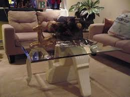 hand crafted swan coffee table base carved from wood by