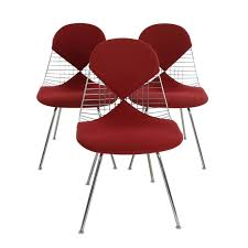 wire chair dkx 5 by ray and charles eames with red cover