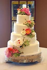 wedding cakes near me white wedding cake with cascading fresh flowers bakes