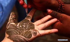 people put henna tattoos on hands to mark shrawan in nepal