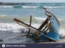 shipwreck washed up wooden boat on beach canary islands stock