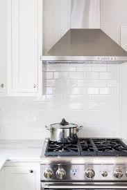 kitchen range backsplash white kitchen cabinets with all white subway tiles cottage kitchen