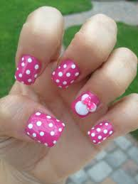 minnie mouse nails pink nails with white polka dots and on ring