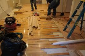 elegant laminate grey wood floors with white wooden pillars as