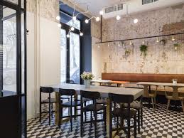 Bar Interior Design Black And White Flooring Rough Cement Wall Decoration Metal